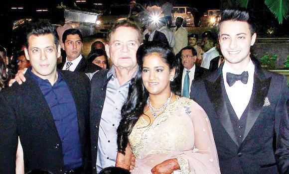 Bride Arpita Khan and the groom Aayush Sharma with Salman Khan and father Salim Khan.