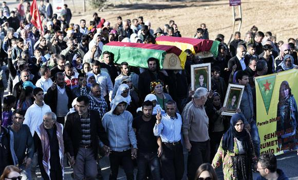 Kurdish people carry the coffins of a People's Protection Unit (YPG) fighter and a Kurdish Women's Protection Unit (YPJ) fighter who died during fighting in the besieged Syrian border town of Kobane, during a funeral in the town of Suruc, Sanliurfa province, in this Nov. 7, 2014 photo.