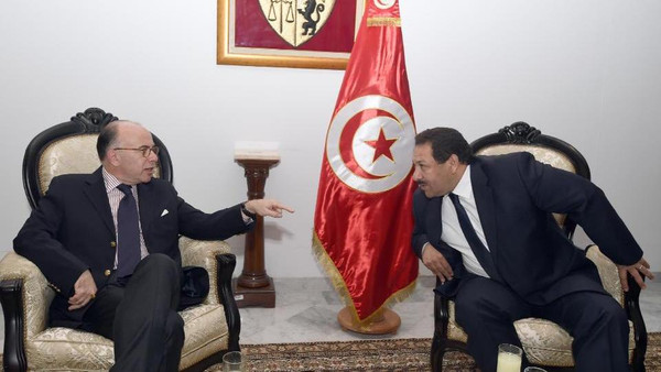 Tunisia's Minister of Interior, Lotfi Ben Jeddou (R) smiles with his French counterpart Bernard Cazeneuve (L) in Tunis on November 10, 2014.
