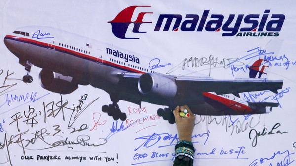 A board for passengers onboard missing Malaysia Airlines Flight MH370 and their family members.