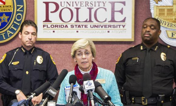 Mary Coburn, vice president of student affairs, center, talks to the media during a news conference about a shooting at the Strozier Library on the Florida State University campus on Thursday in Tallahassee, Florida.
