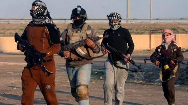 Militants from the Islamic State of Iraq and Syria (ISIS) beheaded eight Syrian rebels who had surrendered in a town on the border with Iraq.