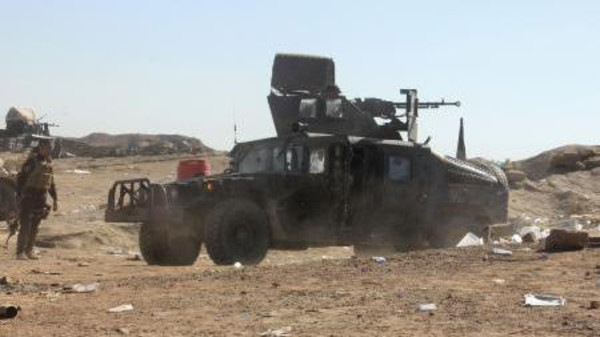 Military vehicles of the Iraqi security forces are seen during an intensive security deployment against ISIS militants in the Hamrin mountains of Diyala province November 8, 2014.