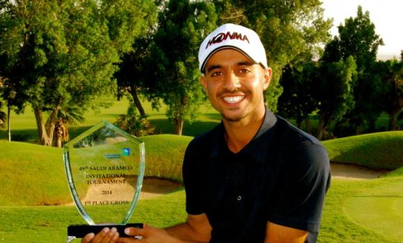 Othman Almulla poses with trophy after winning the 49th Saudi Aramco Invitational Tournament.