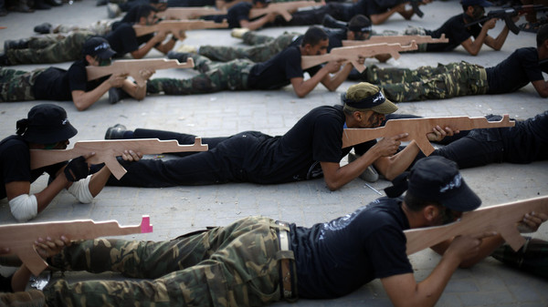 Palestinian members of the Hamas' Popular Army shows their skills during a graduation ceremony in Jabalia, in the northern Gaza Strip on Nov. 7, 2014.