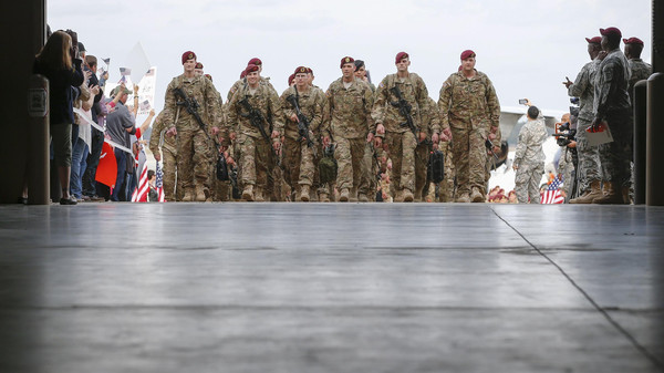 Paratroopers with the 1st Brigade Combat Team, 82nd Airborne Division, march up the ramp as they return home from Afghanistan at Pope Army Airfield in Fort Bragg, North Carolina Nov. 5, 2014.