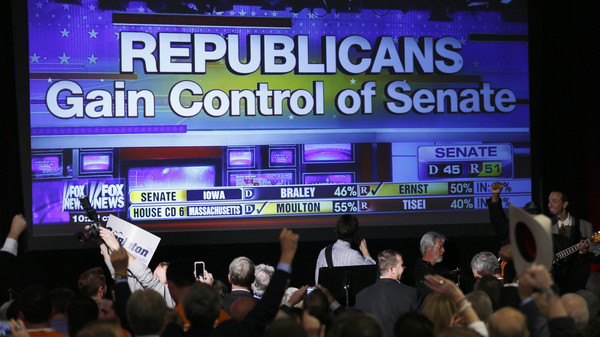 Republican supporters cheer as a giant TV screen displays the results of the Senate race in the U.S. midterm elections in Denver, Colorado, November 4, 2014.