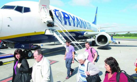 Passengers as they exit a Ryanair flight at Dublin Airport.