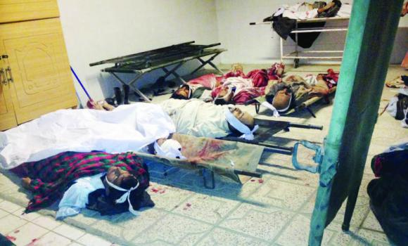 Bodies of civilians are laid out a hospital after a suicide attack in the Yahyakhail district of Paktika province east of Kabul on Sunday.