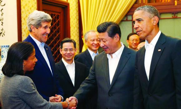 US National Security Adviser Susan Rice, left, shakes hands with China's President Xi Jinping, third right, as US Secretary of State John Kerry, second left, and President Barack Obama look on during a meeting after participating in the Asia Pacific Economic Cooperation (APEC) summit, at the Zhongnanhai leadership compound, in Beijing, on Tuesday.