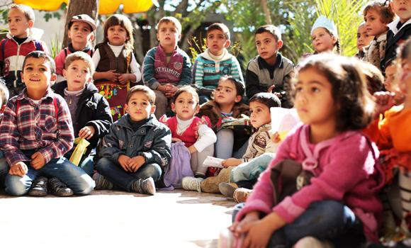 Syrian children attend a class at the Nabaa Al-Hayat centre for education and psychological support for children in places undergoing crisis in the rebel-held Eastern Ghouta region on the outskirts of the capital, Damascus, in this October 22, 2014 photo.