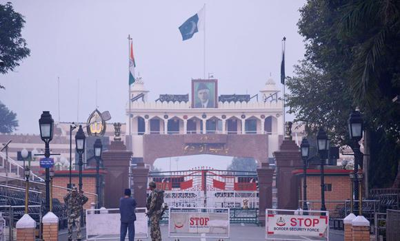 Indian Border Security Force (BSF) personnel stand guard at the Wagah India-Pakistan International Border on Monday, following a suicide bomb attack on the Pakistani side of the Wagah border gate, killing at least 55 people the day before.