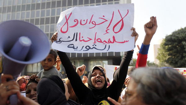Women shout slogans against the government and members of the Muslim Brotherhood and Salafists during a protest against the absence of a women parliamentary quota in the constitution and to demand more women rights in front of the Shura Council in Cairo November 13, 2013.