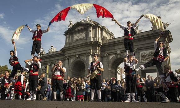 Musicians perform after shepherds led their sheep through the center of Madrid on Sunday.