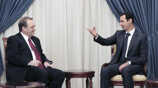 Syria's President Bashar al-Assad (R) meets Russia's Deputy Foreign Minister Mikhail Bogdanov in Damascus.