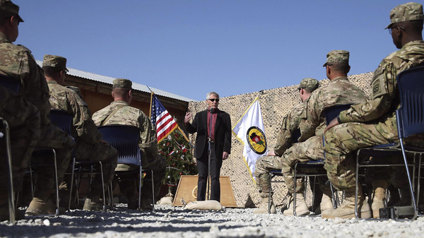 U.S. Defense Secretary Chuck Hagel speaks to American troops during a visit to Forward Operating Base Gamberi December 7, 2014.