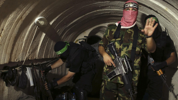 4A Palestinian fighter from the Izz el-Deen al-Qassam Brigades, the armed wing of the Hamas movement, gestures inside an underground tunnel in Gaza.