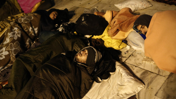 Syrian refugees sleep at the main Syntagma square in Athens December 5, 2014.