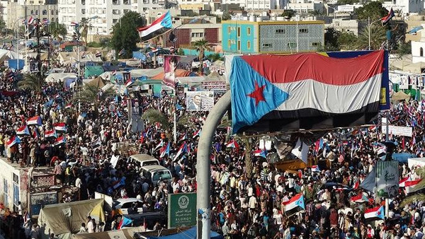 Yemani protesters wave flags and march through the streets during a demonstration demanding renewed independence in the southern city of Aden on Nov. 30, 2014.