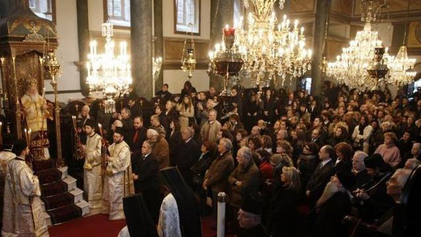 Greek Orthodox Patriarch Bartholomew (L) blesses believers during a Christmas mass in Aya Yorgi (St. George) church at Fener Greek orthodox patriarchate in Istanbul.
