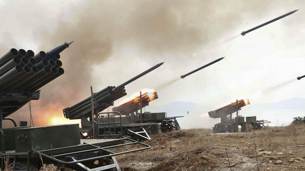 A view of artillery fire and landing exercises guided by North Korean leader Kim Jong Un (not seen) in this undated photo released by North Korea's Korean Central News Agency (KCNA) in Pyongyang Feb. 21, 2015.