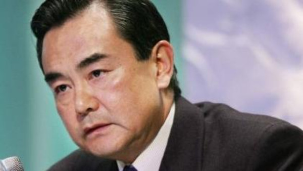 A deal with Iran on its controversial nuclear programme would help it escape from sanctions and allow more efforts to be spent on economic development, Chinese Foreign Minister Wang Yi said.