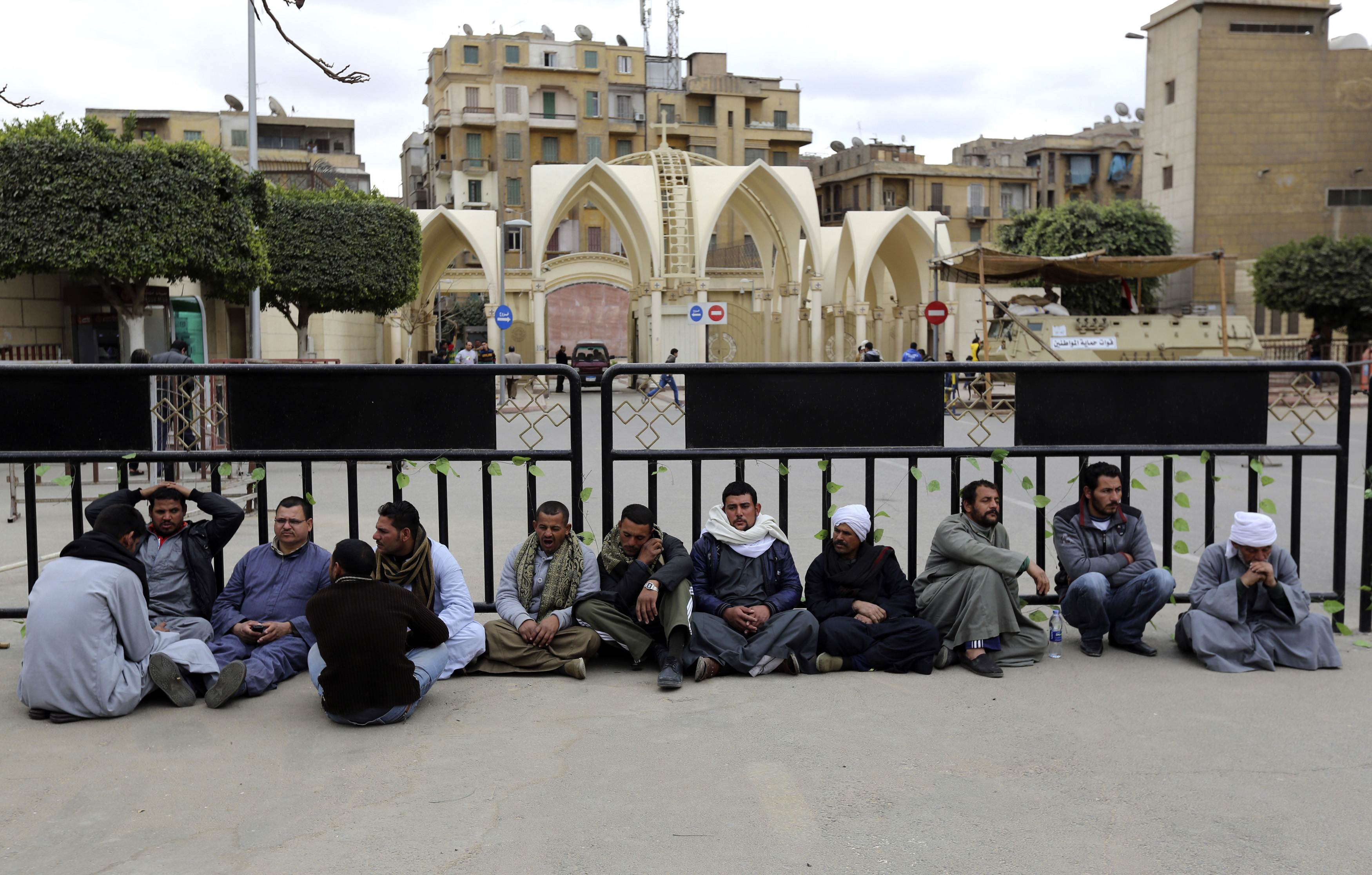 Family members of 27 Egyptian Coptic Christian workers kidnapped in the Libyan city of Sirte, take part in a sit-in inside the compound of Saint Mark's Coptic Orthodox Cathedral to call for the release of their relatives, in Cairo.