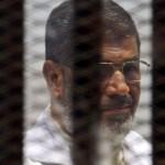 Egypt court puts Mursi on trial over Qatar link