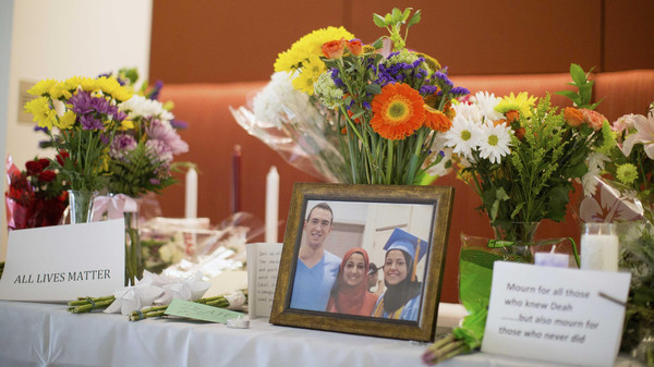 A makeshift memorial for Deah Shaddy Barakat, his wife Yusor Mohammad and Yusor's sister Razan Mohammad Abu-Salha, who were killed by a gunman, is pictured inside of the University of North Carolina School of Dentistry, in Chapel Hill, North Carolina Feb. 11, 2015.