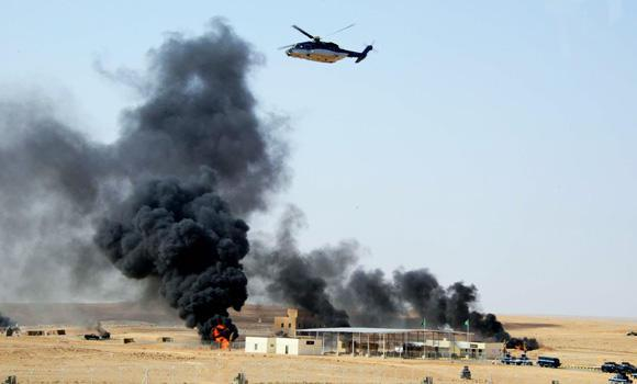 A helicopter hovers over the site of a simulated terror attack on the last day of a mobilization exercise in Arar. (SPA)