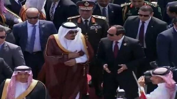 Egyptian President Abdel Fattah al-Sisi welcoming Saudi King Salman as he arrived to the Red Sea resort of Sharm El-Sheikh to attend the 26th Arab League Summit.