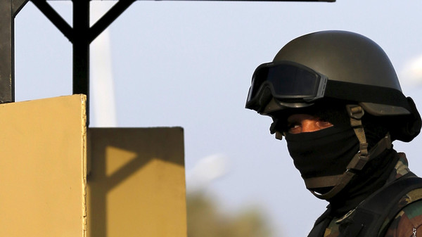 An Egyptian Republican Guard monitors his positions around the congress hall during the Arab Summit in Sharm el-Sheikh, in the South Sinai governorate, south of Cairo, March 28, 2015.