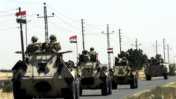 Egyptian soldiers move into Arish, northern Sinai.