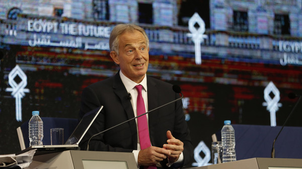Former British Prime Minister Tony Blair speaks with international broadcaster Nik Gowing at an economic conference, in Sharm el-Sheikh, Egypt, Saturday, March 14, 2015.