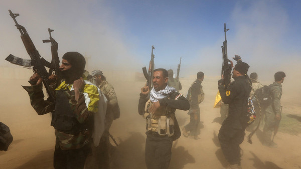 Iraqi fighters of the government-controlled Popular Mobilization units take part in a military operation to take control of Tikrit, 160 kms north of Baghdad, from jihadists from ISIS group, on March 11 2015.