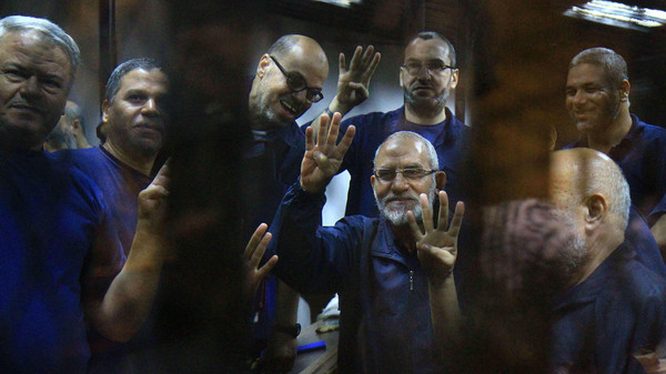 Muslim Brotherhood leader Mohammad Badie behind the bars.