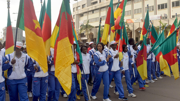 People wave Cameroon's national flag as they take part in a demonstration on Feb. 28, 2015 in downtown Yaounde, against Islamist group Boko Haram.