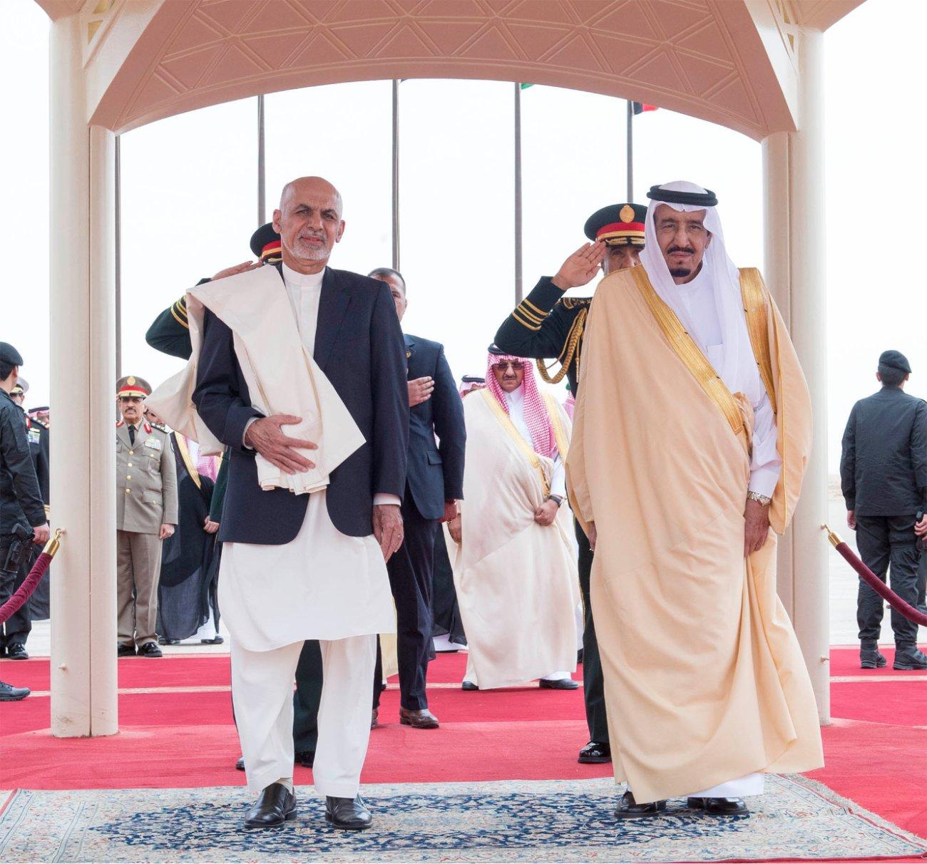 Saudi King Salman bin Abdulaziz al-Saud (R) and Afghanistan's President Ashraf Ghani (L) are seen during a welcoming ceremony at King Khaled International Airport in Riyadh. (SPA)