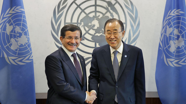 United Nations Secretary General Ban Ki-moon, right, shakes hands with Ahmet Davutoglu, Prime Minster of Turkey, at UN headquarters, Thursday, March 5, 2015.