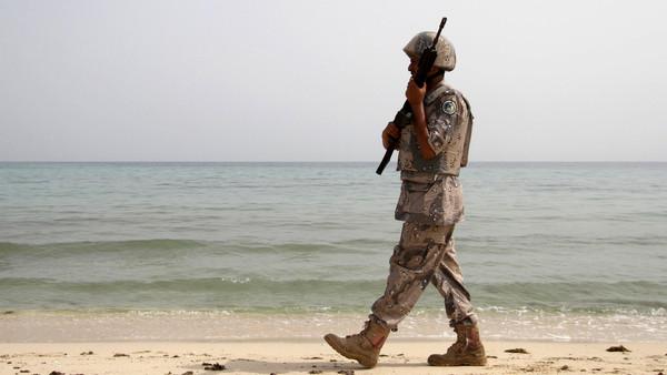 A Saudi border guard patrols near Saudi Arabia's border with Yemen, along beach on Red Sea, near Jizan.