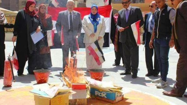 An Education Ministry official from and government officials burned the books in the courtyard of one of the Fadl Schools.