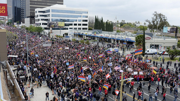 Demonstrators march arrive to the Turkish consulate to commemorate the 100th anniversary of mass killing of Armenians by Ottoman Turks, in Los Angeles.