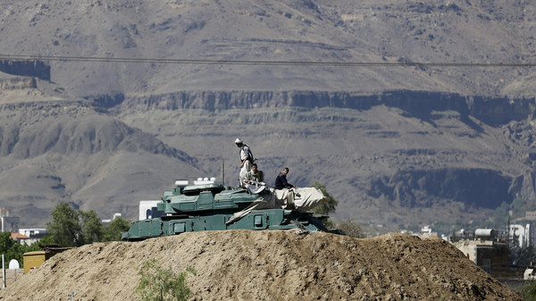 Houthi fighters sit on a tank near the Presidential Palace in Sanaa March 25, 2015.