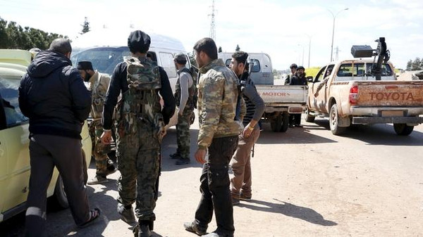 Members of al-Qaeda's Nusra Front man a checkpoint at the entrance of Idlib city.