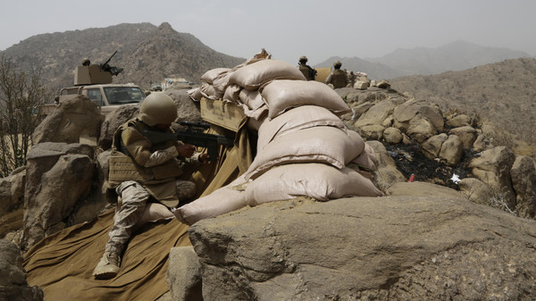 Saudi soldiers on watch from behind sandbag barricade at the border with Yemen in Jazan, Saudi Arabia, Monday, April 20, 2015.