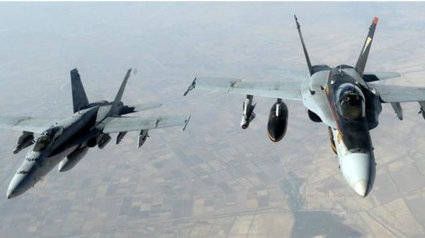 The strikes in Syria hit targets near Kobani, destroying four fighting positions and a boat, the statement said.