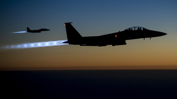 U.S.-led forces targeted Islamic State of Iraq and Syria (ISIS) militants in Syria with three air strikes and conducted another 15 strikes against the group in Iraq.