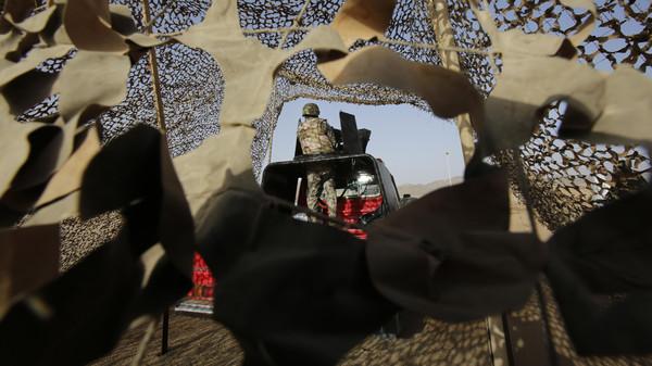 In this Tuesday, April 21, 2015 file photo, a Saudi soldier stands alert, on the Saudi-Yemen border in Najran, Saudi Arabia.