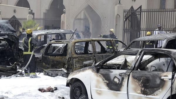 Firemen work at the site where a car exploded near a Shi'ite mosque in Saudi Arabia's Dammam