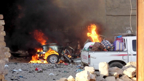 A car is engulfed by flames during clashes in the city of Ramadi, May 16, 2015. Islamic State militants drove security forces from a key military base in western Iraq on Sunday and Prime Minister Haider al-Abadi authorized the deployment of Shi'ite paramilitaries to wrest back control of the mainly Sunni province. Picture taken May 16, 2015.